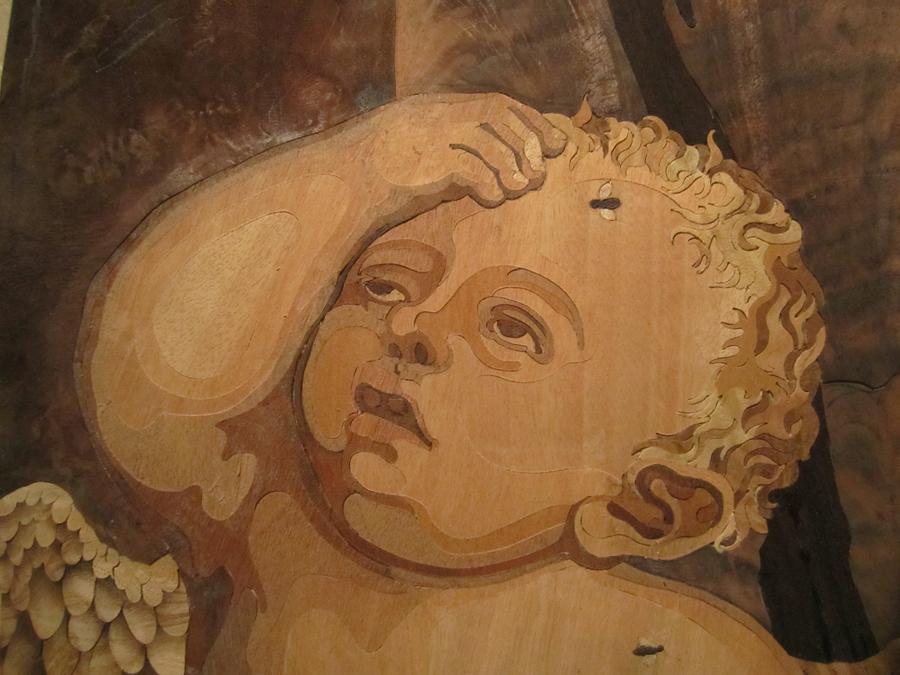 Detall de la cara de Cupido.