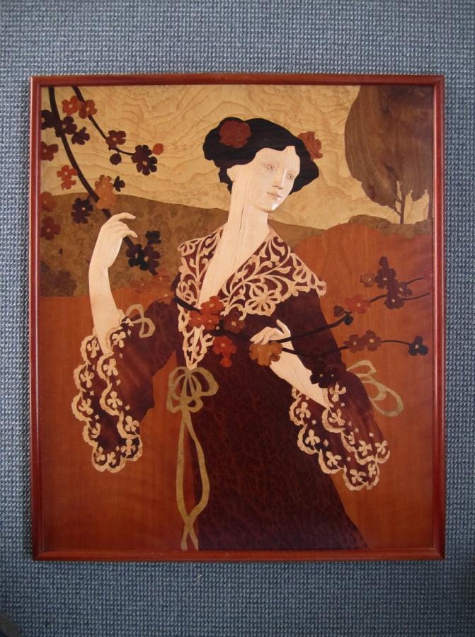 Marqueteria modernista, dama agafant una branca florida