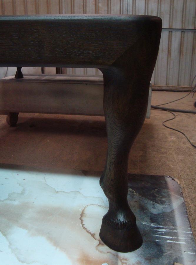 Taula baixa amb potes de cavall